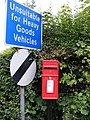Postbox, and Roadsign, Bigsby's Corner - geograph.org.uk - 1404967.jpg