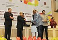 """Pranab Mukherjee presenting the Rajat Kamal Award for Best Animation Film """"Sound of Joy"""", in Non Feature Films Section to the Producer, Aura Cinematics, Rep Shri Dipankar Sarkar at the 62nd National Film Awards Function.jpg"""