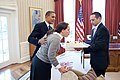 President Barack Obama surprises Personal Secretary Katie Johnson with a gift and birthday cake in the Oval Office.jpg