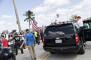 March 4 Trump - Trump waves to supporters at a rally in West Palm Beach, Florida
