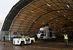 Puma helicopter of Pakistan Aviation Unit being towed out of maintenance hangar at Kavumu Airport.jpg