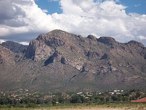 View of Pusch Ridge in the Santa Catalina Mountains from Oro Valley. September 2004.