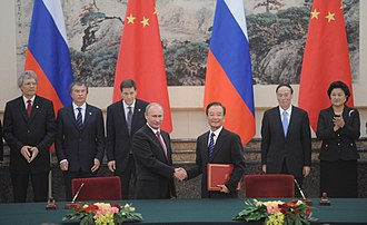 Renminbi - On 24 November 2010, Vladimir Putin announces that Russia's bilateral trade with China will be settled in ruble and yuan, instead of U.S. dollars.