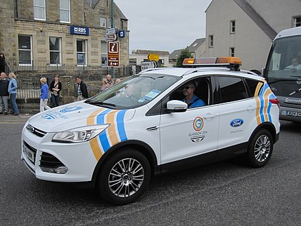 Police Scotland Ford Kuga at the rear of the Queen's Baton Relay, in Olrig Street in Thurso Queen's Baton Relay in Thurso (14435759587).jpg