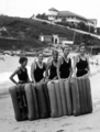 Queensland State Archives 2058 Surfo planing girls Coolangatta c 1934.png