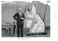 Queensland State Archives 4286 Hon TA Foley MLA at Field Day Tent Hill Gatton 1950.png