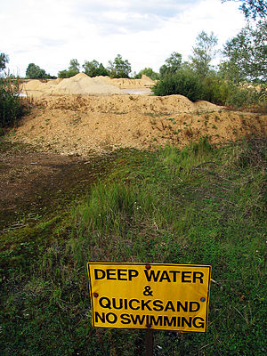 Quicksand - Quicksand and a warning sign about it at a gravel quarry in England