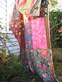 Quilt hanging on line in garden.jpg