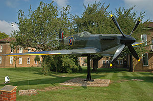 RAF Digby - Fibreglass replica Spitfire Mk IX mounted outside Station HQ