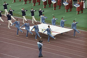Goose step - Athletes goose-stepping with the Olympic flag at the 1980 Summer Olympics in Moscow.