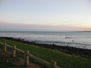 Raglan, New Zealand - Surfers in Manu Bay