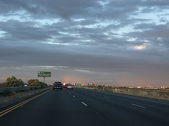 Transportation in the Sacramento metropolitan area - Sacramento as seen from the distance in the eastbound lanes of I-80 in Yolo County