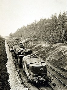 A Russian armoured train, Partizan, is pictured motionless on its tracks. The train is shown to have three cars and a weapon at its front, hidden beneath armour plating. The train assisted the Red war effort in the Vyborg area.
