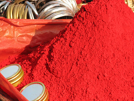 Sindoor is a vermilion-colored powder with which Indian women make a mark in their hairline to indicate they are married. Red tikka powder.jpg
