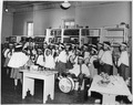 Rhythm band student performing in day school library - NARA - 295164.tif