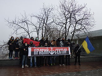 Right Sector - Activists in Odessa holding Right Sector banner with ship-anchor design, 9 February 2014