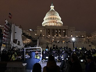 Riot police and protesters outside the Capitol in the evening Riot police and protester outside United States Capitol at evening 20210106.jpg