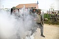 Romanian soldiers with the 1st Company, 22nd Battalion advance through a smoke screen toward role players, not shown, who are acting as rioters during the Kosovo Force (KFOR) 17 Mission Rehearsal Exercise at 130506-A-HJ139-002.jpg
