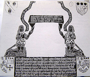 "Warbelton v Gorges - Denys monumental brass at Olveston, Glos., 1505. ""Gorges Modern"" is shown in the 3rd quarter of both the lower shields and on the fronts and sleeves of both tabards. The shield in the upper sinister position shows the Russell arms, the Denys arms being in the upper dexter position"