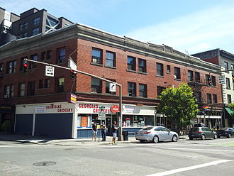 The corner of Southwest 12th Avenue and Stark Street in 2015. The building once housed Three Sisters Tavern in the space now occupied by Scandals, a gay bar. SW 12th and Stark, Portland (2015).jpg