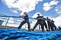Sailors heave line aboard USS Chancellorsville to depart Fleet Activities Yokosuka. (29178274255).jpg