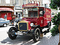 Saint-Vaast-la-Hougue (France), red automobile with adertisement.JPG