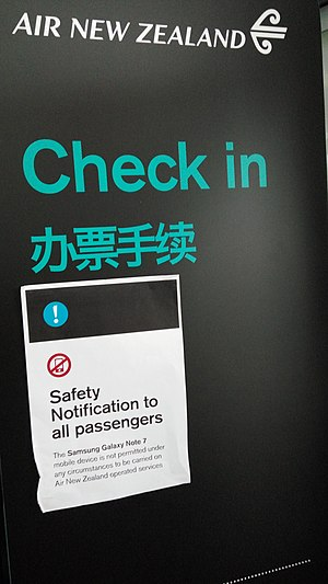 Samsung Galaxy Note 7 - A sign at the Air New Zealand check-in counter in Pudong International Airport warning passengers not to bring Note 7 phones onto the plane.