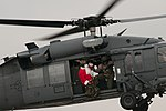 Santa trades sleigh for helicopter, ditches elves for Airmen (Image 6 of 6) (8240992079).jpg