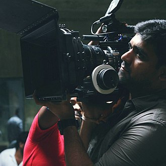 Cameraman along with the equipment for making cinematography. Sathish. G.jpg