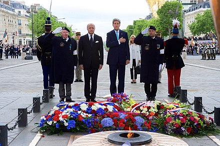 Laurent Fabius, Minister of Foreign Affairs, with John Kerry, U.S. Secretary of State, under the Arc de Triomphe in 2015 Secretary Kerry, French Foreign Minister Fabius, Ambassador Hartley Pause After 70th Anniversary VE Day Wreath-Laying Ceremony in Paris (17421255431).jpg