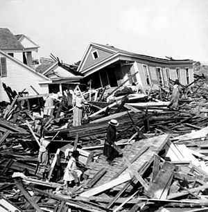 1900 Galveston hurricane - People rummage through rubble of destroyed houses in Galveston several days after the hurricane