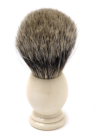 Shave brush - Shaving brush of traditional design. Long rather stiff bristles and a handle that allows it to be held between thumb and middle finger.