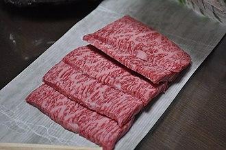 Wagyu - High-grade sliced Matsusaka wagyu beef (rib-section meat), showing characteristic marbling