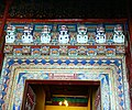Snow Lions above entrance in a Tibetan Monastery on 20 May 2014.jpg