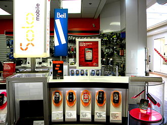 Solo Mobile - Solo Mobile display at The Source. Note the advertisement for Virgin Mobile on top of the display.