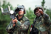 Staff Sgt. Warren Jackson points out a target to Stinger anti-aircraft guided missile gunner Sgt. Gary Cross during the air base ground defense Exercise Foal Eagle '89 DF-ST-90-12024