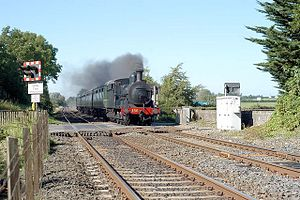 GS&WR Class 101 - Steam passing Drumbane Level Crossing on Northern Ireland Railways metals on a Railway Preservation Society of Ireland service on the Belfast-Dublin railway line.