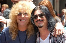 Adler (left) with Gilby Clarke in July 2012