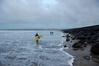 Lahinch - Surfers getting ready to catch some waves at Lahinch.