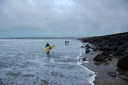 Surfers getting ready to catch some waves at Lahinch.