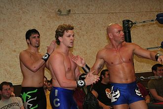 Gran Akuma - Team F.I.S.T. (from left to right: Chuck Taylor, Icarus, and Gran Akuma in May 2008