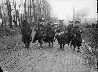 49th (West Riding) Infantry Division - British troops returning from leave, Mailly Maillet, November 1916. The group of soldiers includes men of the Lancashire Fusiliers, York and Lancaster Regiment, and the Duke of Wellington's Regiment (West Riding), from the 49th Division.