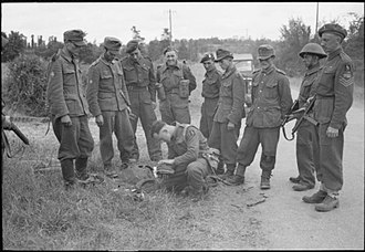 7th Armoured Division (United Kingdom) - German prisoners being searched by soldiers of the 1st Battalion, Rifle Brigade (The Prince Consort's Own) near Tilly-sur-Seulles, Normandy, 13 June 1944.