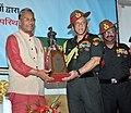 The Chief of Army Staff, General Bipin Rawat presenting a memento to the Chief Minister of Uttarakhand, Shri Trivendra Singh Rawat, in Dehradun on March 18, 2018.jpg