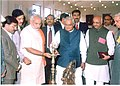 The Prime Minister Shri Atal Bihari Vajpayee and the Chief Minister of Gujarat Shri Narendra Modi lighting the traditional lamp at the inauguration of the G.K. General Hospital in Bhuj (Gujarat) on January 14, 2004.jpg