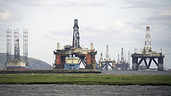 Offshore drilling rigs and a platform supply vessel in Devil's Cove for repairs