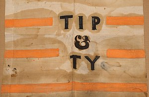 "Tippecanoe and Tyler Too - A campaign banner with the ""Tip and Ty"" slogan, derived from the song."