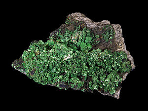Entraygues-sur-Truyère - Torbernite from the Margabal Mine, Entraygues-sur-Truyère. Size: 15.3 x 9.6 x 5.6 cm.
