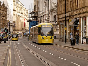 Manchester Metrolink City Zone - Two M5000 trams running on the Second City Crossing (2CC) in Cross Street in 2017. The 2CC added a second crossing through Manchester to eliminate a bottleneck.