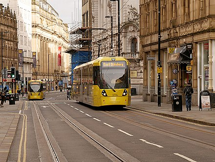 Two trams running on the Second City Crossing (2CC) in Cross Street in 2017 Trams on Cross Street, Metrolink Second City Crossing, David Dixon, 5301810.jpg